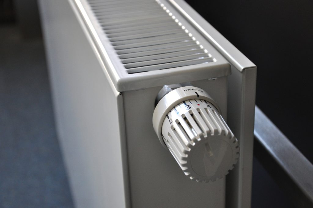 radiator, central heating, how to decide between electric and gas central heating